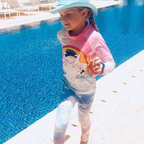 Halston's favorite 2pc Rash Guard Set - Lucky Unicorns with #Swimlids -the funky bucket hat in aqua - such a chic combination. Dorado Beach, Dorado, Puerto Rico - La Isla del Encanto! #upf50 #kidsrashguards #kidsleggings #kidssunhats #keepthemsafe @doradobeachreserve