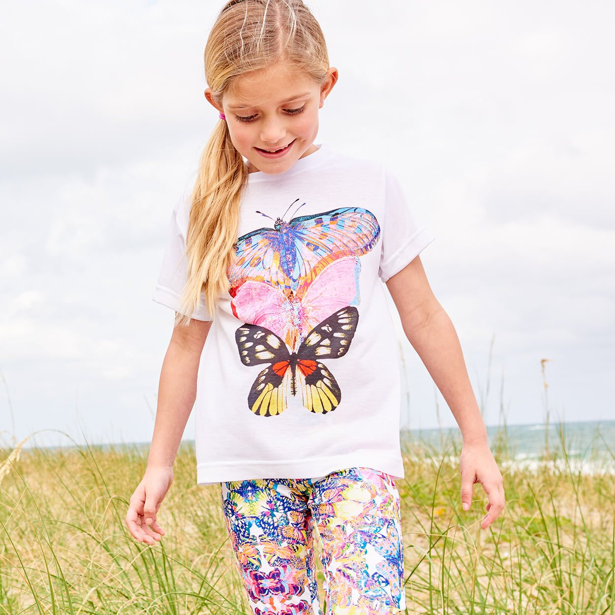 Girls Butterfly Art Graphic Tshirt Size Xs L White Pink Blue Opaline World Little Girl On The Beach Looking For Shells Sunpoplife