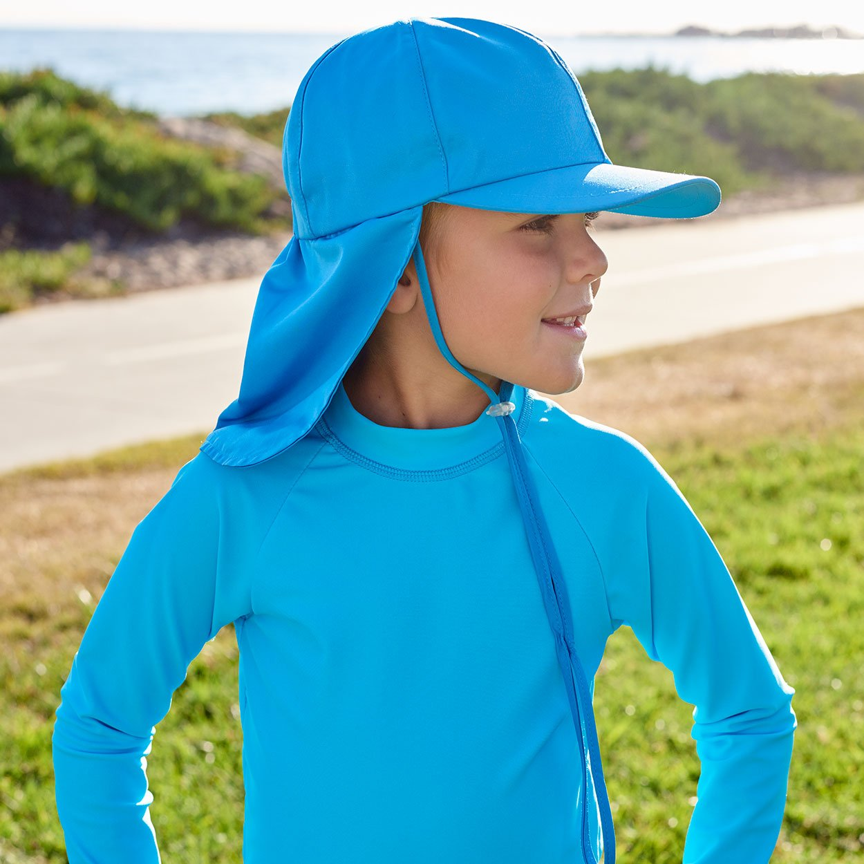 Kids Blue Legionnaire Sun Hat Upf 50 Size S Xl Boy Looking Away Wearing Blue Hat on the Park Sunpoplife