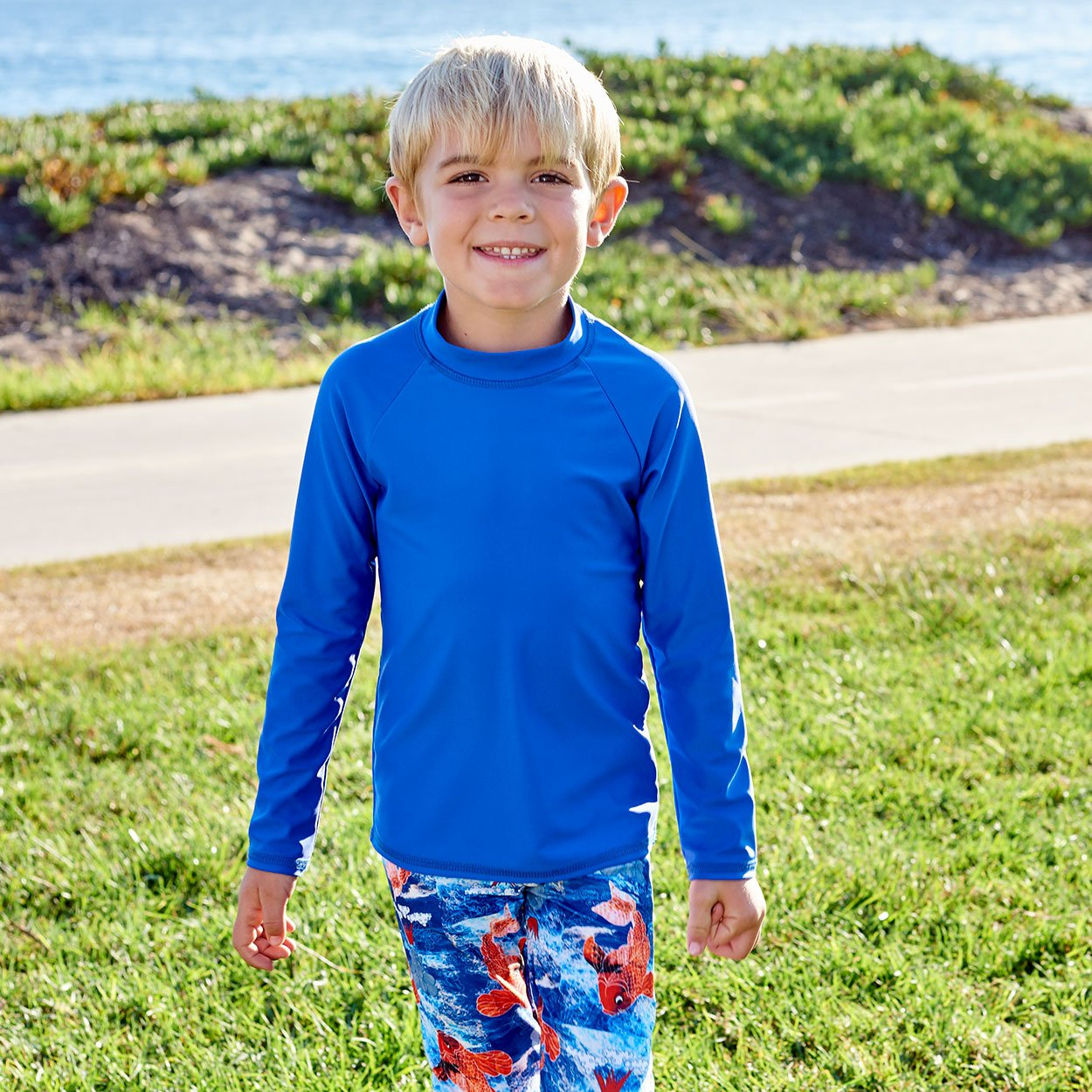 Royal Blue Kids Long Sleeve Rash Guard Top Upf50 Boys Girls Unisex Size 2 12 Blonde Boy Smiling by the Ocean Sunpoplife