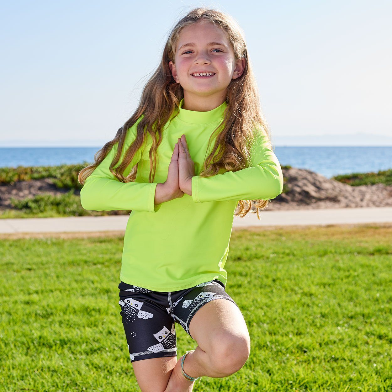 Yellow Kids Long Sleeve Rash Guard Top Upf50 Boys Girls Unisex Size 2 12 Girl Doing Yoga by the Beach Sunpoplife